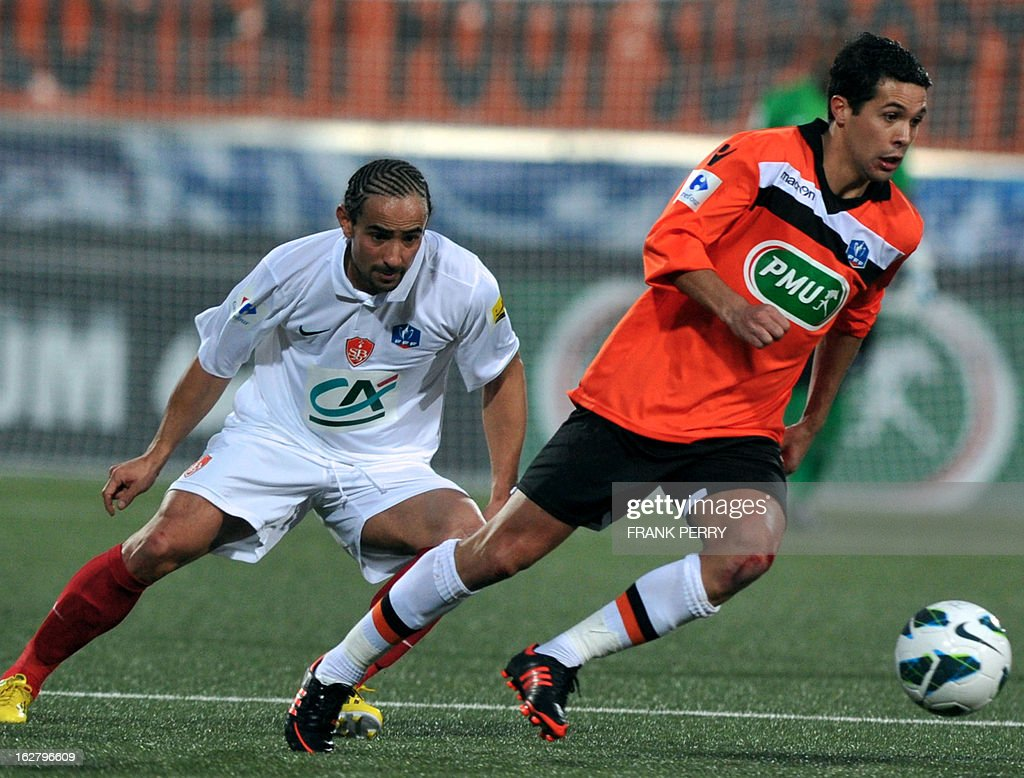 Brest's French midfielder Bruno Grougi (L) vies with Lorient's French forward Fabien Robert (R) controls the ball during the French Cup football match Lorient vs Brest, on February 27, 2013 at the Stadium of Moustoir in Lorient, western France.