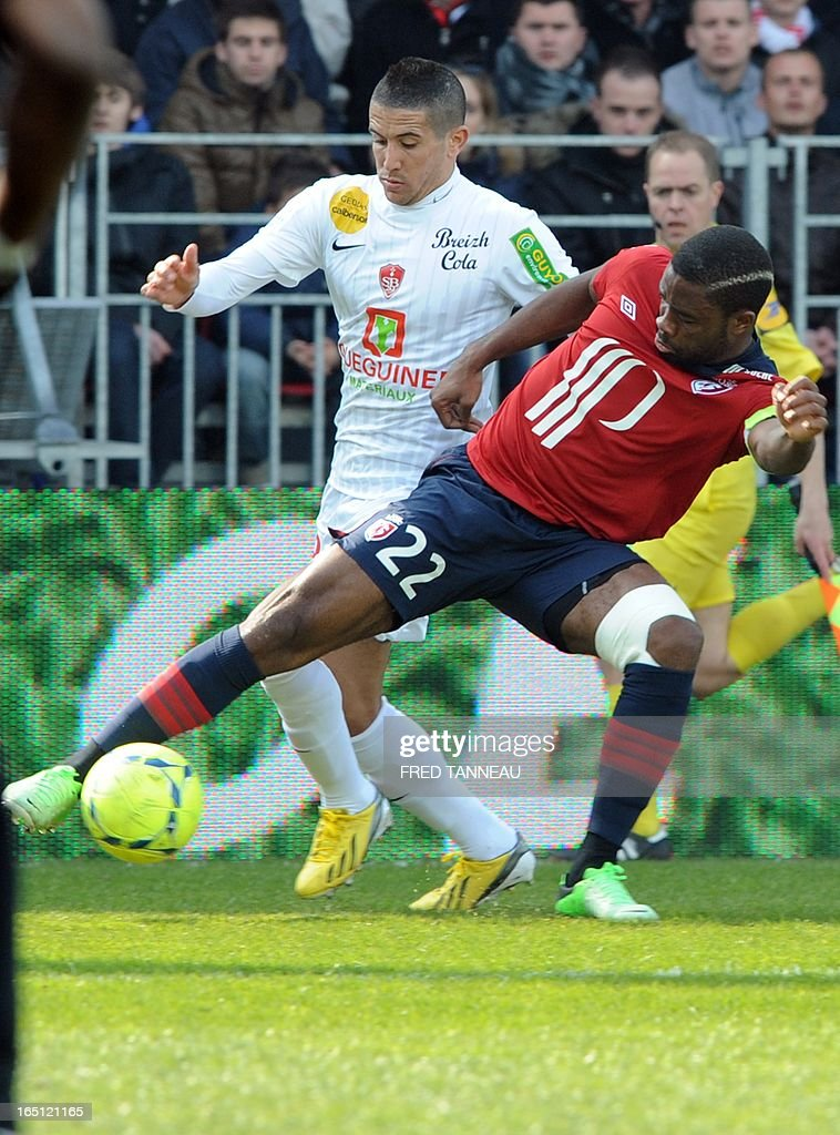 Brest's French midfielder Florian Raspentino (L) vies for the ball with Lille's Cameroonian midfielder Aurelien Chedjou Fongang during the French L1 match Brest vs Lille at the Francis Le Blé stadium on March 31, 2013 in Brest, western France.