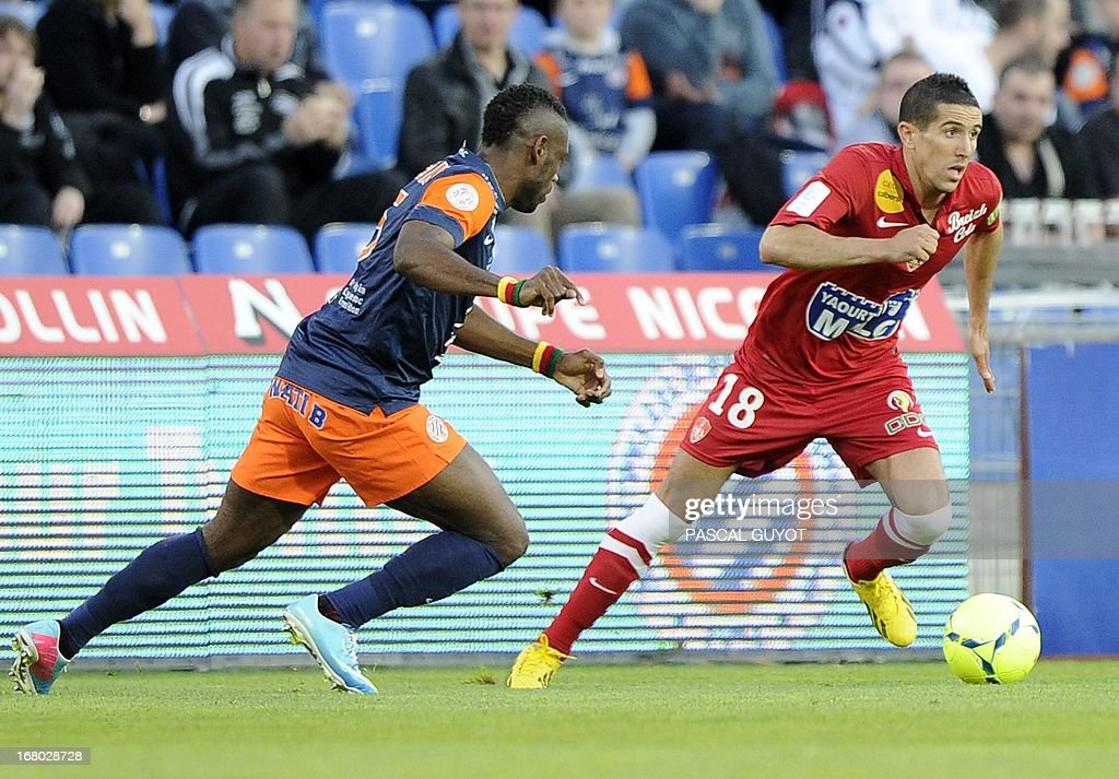 Brest's French midfielder Florian Raspentino (R) vies with Montpellier's Cameroonian defender Henri Bedimo (L) during the French L1 football match Montpellier vs Brest on May 4, 2013 at the Mosson stadium in Montpellier, southern France.