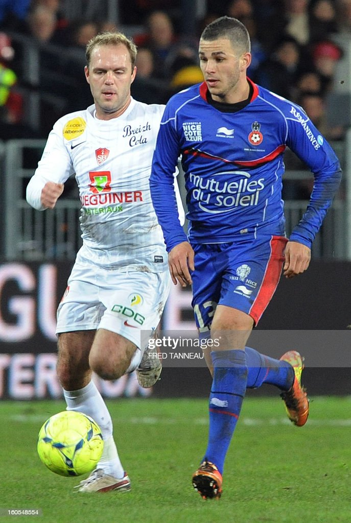 Brest's French midfileder Geoffrey Dernis (L) vies with Nice's French midfielder Valentin Eysseric during the French L1 football match Brest vs Nice at the Francis Le Ble stadium on February 2, 2013 in Brest western France.