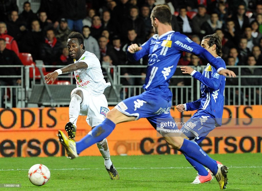 Brest's Guinean forward Larsen Toure vies for the ball with Bastia's French defender Matthieu Sans and Bastia's Algerian defender Fethi Harek during...