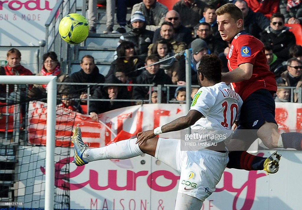 Brest's Guinean forward Larsen Toure (L) vies for the ball with Lille's French defender Lucas Digne during the French L1 football match Brest vs Lille on March 31, 2013 at the Francis Le Ble stadium in Brest, western France.