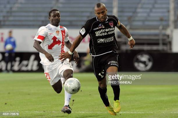 Brest's midfielder Cheick Doumbia fights for the ball with ClermontFerrand's forward Harry Novillo during the French L2 football match between Brest...