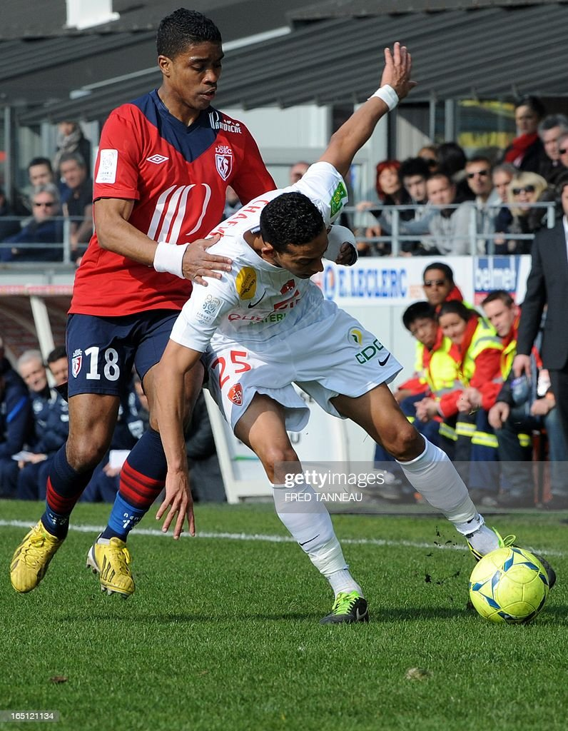 Brest's Moroccan midfielder Kamel Chafni (R) vies for the ball with Lille's French defender Franck Beria during the French L1 match Brest vs Lille at the Francis Le Blé stadium on March 31, 2013 in Brest, western France.