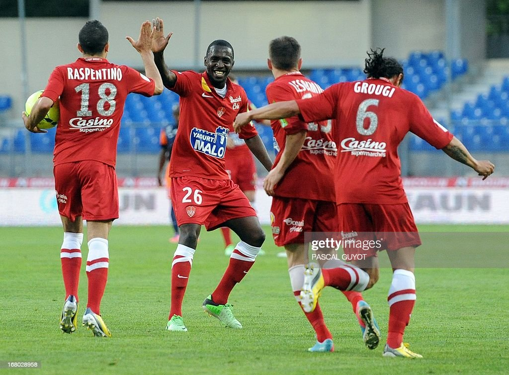 Brest's players celebrate after scoring during the French L1 football match Montpellier vs Brest on May 4, 2013 at the Mosson stadium in Montpellier, southern France.