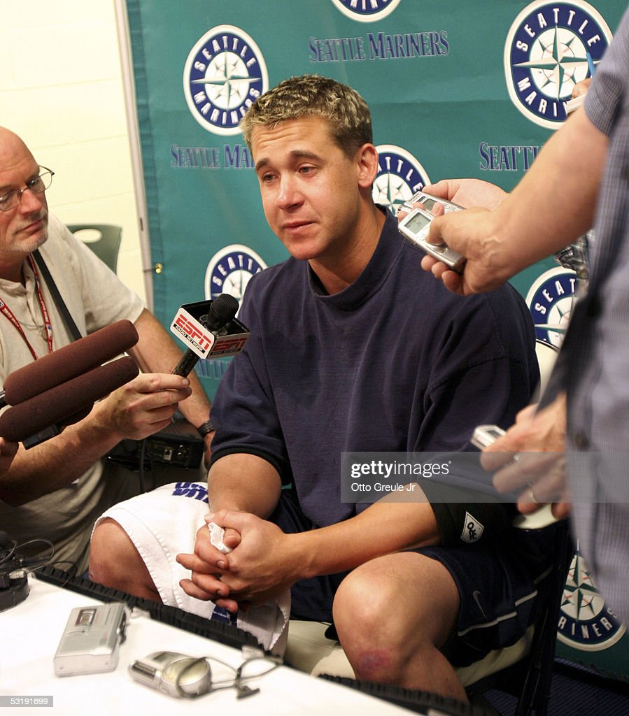 Bret Boone of the Seattle Mariners talks to the media at a press conference announcing he has been designated for assignment by the Mariners after a...
