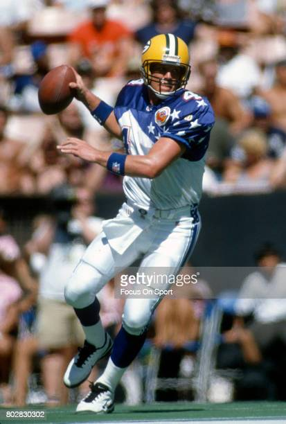 Bret Favre of the NFC drops back to pass against the AFC during the 1996 NFL Pro Bowl Game February 4 1996 at Aloha Stadium in Honolulu Hawaii The...