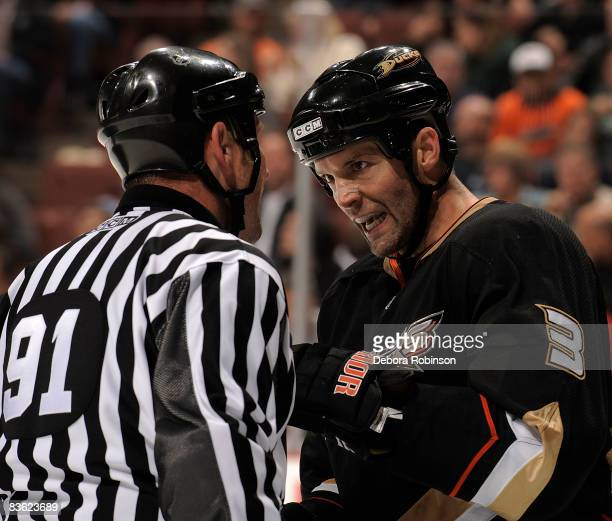 Bret Hedican of the Anaheim Ducks argues with linesmen Don Henderson during the game against the Florida Panthers on November 9 2008 at Honda Center...
