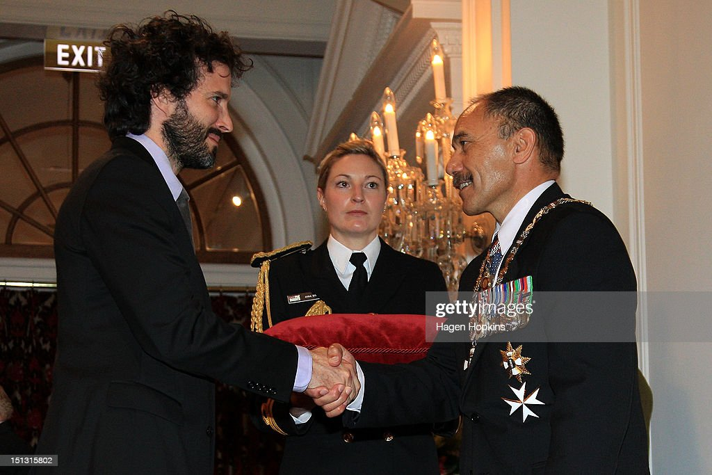 Bret McKenzie is presented with the Insignia of the Queen's Service Order by Governor-General Sir Jerry Mateparae during the Governor General's bienniel Investiture Ceremonies held for recipients of the New Year and Queen's Birthday honours at Government House on September 6, 2012 in Wellington, New Zealand.