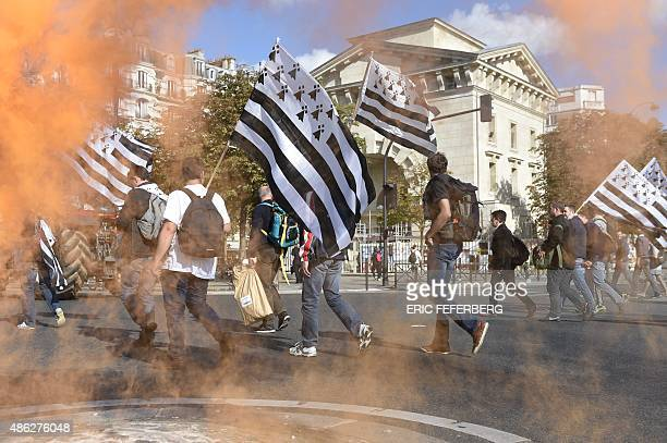 Breton farmers holding Breton flags arrive in Place de la Nation in Paris as they take part in a national demonstration on September 3 to protest...