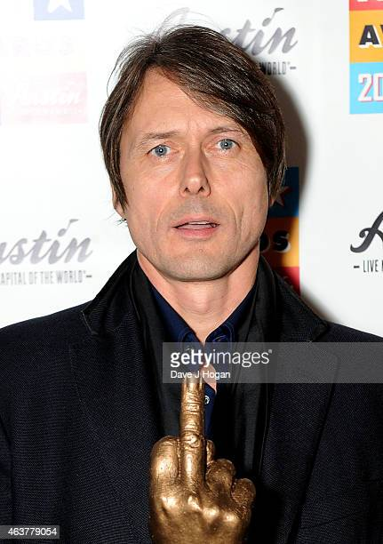 Brett Anderson of Suede receives the God Like Genius Award in the winners room at the NME Awards at Brixton Academy on February 18 2015 in London...