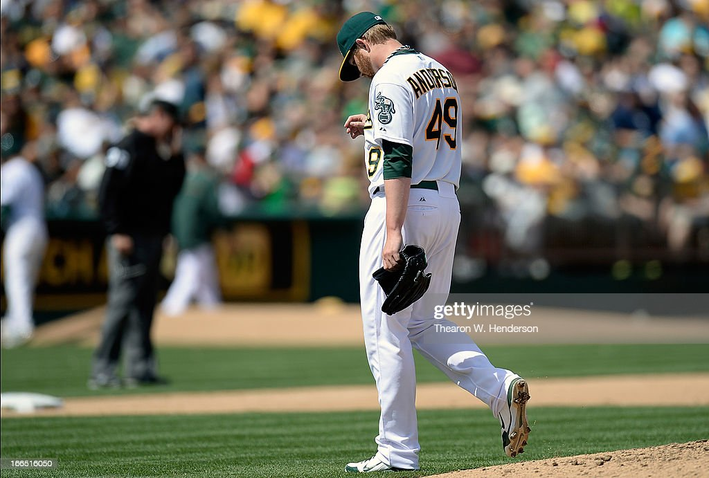 Brett Anderson #49 of the Oakland Athletics walks off the mound after being taken out of the game against the Detroit Tigers in the six inning at O.co Coliseum on April 13, 2013 in Oakland, California.