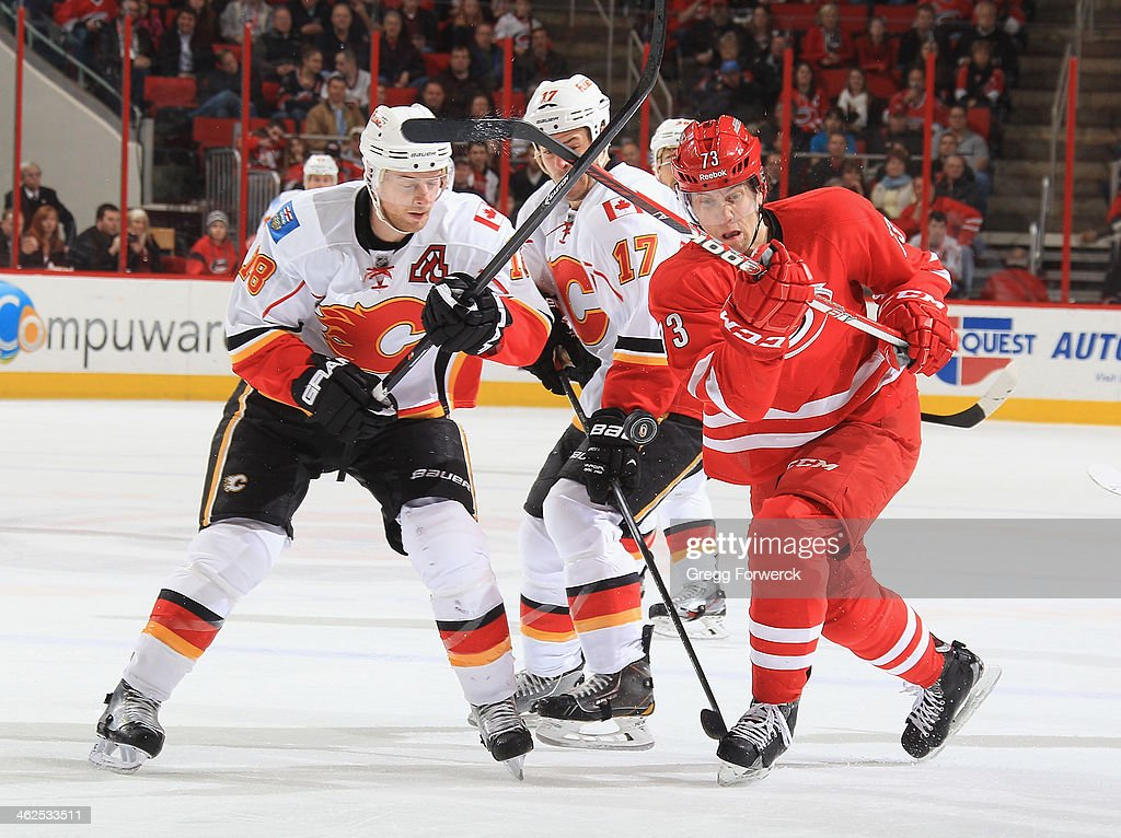 <a gi-track='captionPersonalityLinkClicked' href=/galleries/search?phrase=Brett+Bellemore&family=editorial&specificpeople=4270909 ng-click='$event.stopPropagation()'>Brett Bellemore</a> #73 of the Carolina Hurricanes battles for the puck against Matt Stajan #18 and <a gi-track='captionPersonalityLinkClicked' href=/galleries/search?phrase=Lance+Bouma&family=editorial&specificpeople=4303790 ng-click='$event.stopPropagation()'>Lance Bouma</a> #17 of the Calgary Flames during their NHL game at PNC Arena on January 13, 2014 in Raleigh, North Carolina.