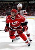 Brett Bellemore of the Carolina Hurricanes is shoved by Ilya Kovalchuk of the New Jersey Devils during their NHL game at PNC Arena on March 21 2013...