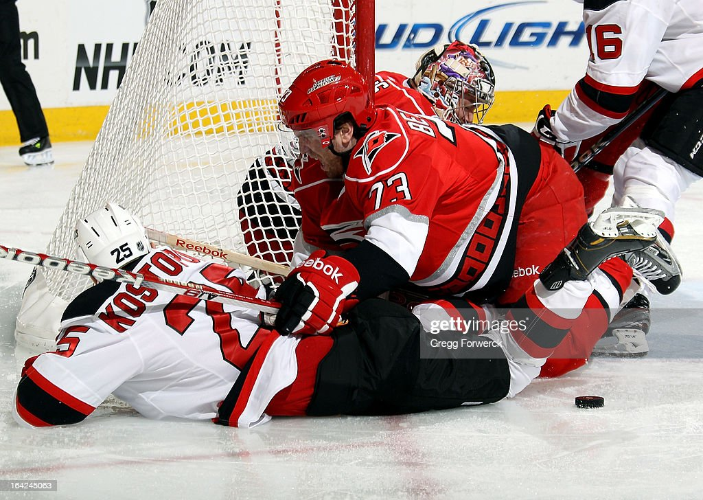 Brett Bellemore #73 of the Carolina Hurricanes knocks <a gi-track='captionPersonalityLinkClicked' href=/galleries/search?phrase=Tom+Kostopoulos&family=editorial&specificpeople=209030 ng-click='$event.stopPropagation()'>Tom Kostopoulos</a> #25 of the New Jersey Devils away from the puck and clear of the crease during their NHL game at PNC Arena on March 21, 2013 in Raleigh, North Carolina. Bellemore was recalled on Wednesday from the Charlotte Checkers (AHL) to fill a spot in lineup left by an injured Justin Faulk, out two-to-four weeks with a second-degree MCL sprain.