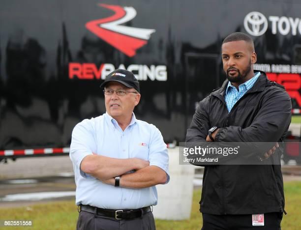 Brett Bodine and Jusan Hamilton talk at the 2017 NASCAR Drive for Diversity at New Smyrna Speedway on October 17 2017 in New Smyrna Florida
