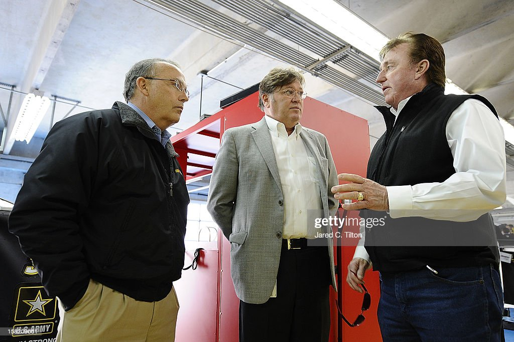 Brett Bodine, NASCAR Sprint Cup Series pace car driver, Robin Pemberton, vice president of competition for NASCAR, and Richard Childress, owner of Richard Childress Racing, speak in the garage area during testing at Charlotte Motor Speedway on December 11, 2012 in Concord, North Carolina.