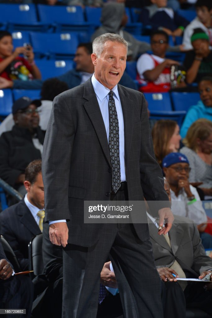 <a gi-track='captionPersonalityLinkClicked' href=/galleries/search?phrase=Brett+Brown&family=editorial&specificpeople=2119406 ng-click='$event.stopPropagation()'>Brett Brown</a> of the Philadelphia 76ers coaches against the Boston Celtics at the Bob Carpenter Center on October 11, 2013 in Newark, Delaware.