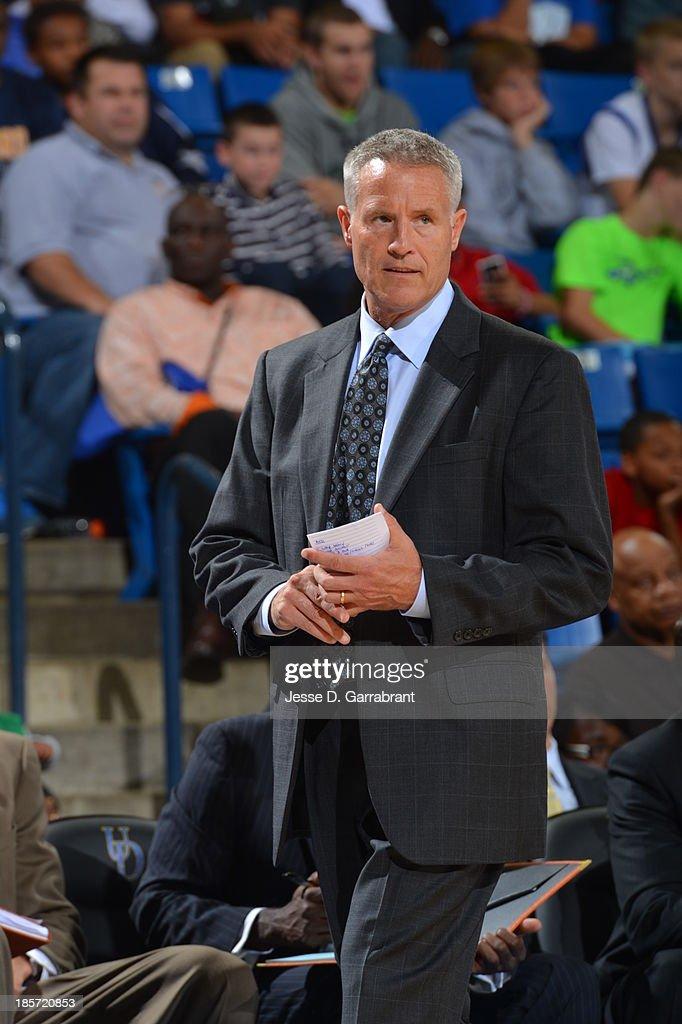 Brett Brown of the Philadelphia 76ers coaches against the Boston Celtics at the Bob Carpenter Center on October 11, 2013 in Newark, Delaware.