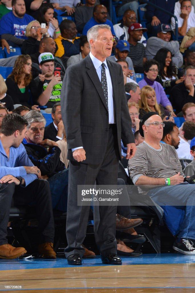 Brett Brown of the Philadelphia 76ers coaches during the game against the Boston Celtics at the Bob Carpenter Center on October 11, 2013 in Newark, Delaware.
