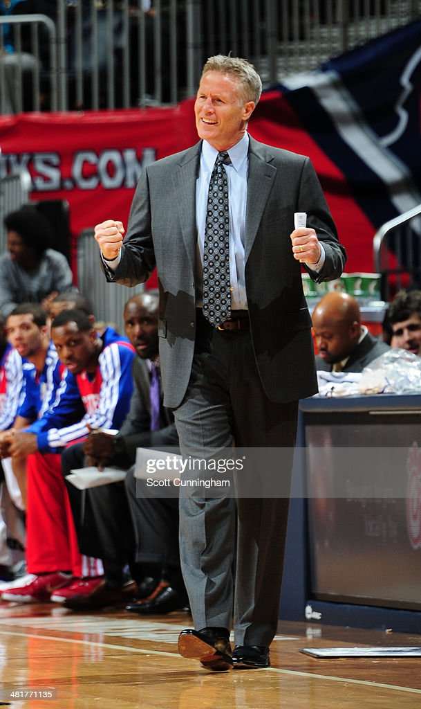 Brett Brown of the Philadelphia 76ers reacts during the game against the Atlanta Hawks on March 31, 2014 at Philips Arena in Atlanta, Georgia.