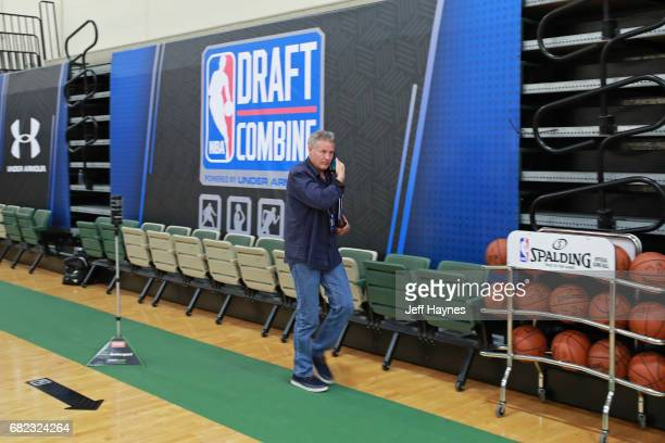Brett Brown of the Philadelphia 76ers talks on the phone during the NBA Draft Combine at the Quest Multisport Center on May 11 2017 in Chicago...