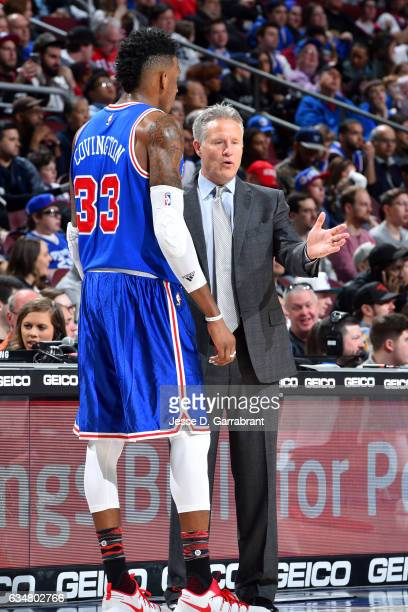 Brett Brown of the Philadelphia 76ers talks with Robert Covington of the Philadelphia 76ers during the game against the Miami Heat on February 11...