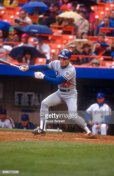 Brett Butler of the Los Angeles Dodgers swings at the pitch during an MLB game against the New York Mets on May 10 1992 at Shea Stadium in Flushing...