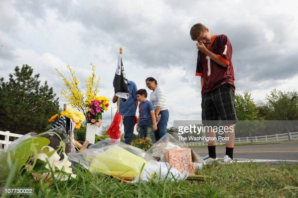 Brett Campbell gets emotional as as Emilio Bryan and Maria Mendoza leave the site where 15yearold Centreville boy John Donald Rupp aka Bo died Sunday...