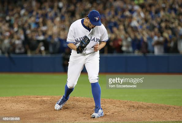 Brett Cecil of the Toronto Blue Jays celebrates after getting the last out of the eighth inning during MLB game action against the New York Yankees...