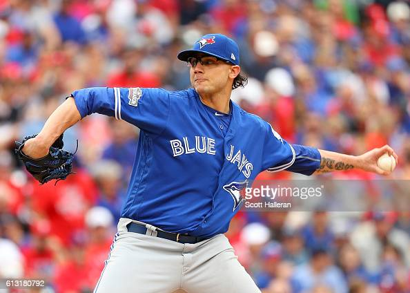 Brett Cecil of the Toronto Blue Jays delivers a pitch against the Texas Rangers during the seventh inning of game two of the American League Divison...