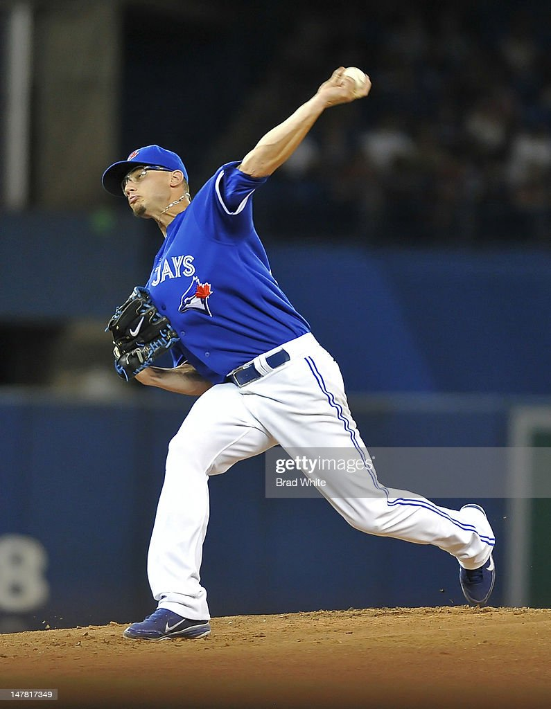 <a gi-track='captionPersonalityLinkClicked' href=/galleries/search?phrase=Brett+Cecil&family=editorial&specificpeople=4556338 ng-click='$event.stopPropagation()'>Brett Cecil</a> #27 of the Toronto Blue Jays delivers a pitch during MLB game action against the Kansas City Royals July 3, 2012 at Rogers Centre in Toronto, Ontario, Canada.