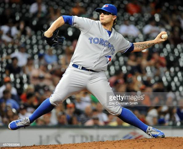 Brett Cecil of the Toronto Blue Jays delivers a pitch during the sixth inning against the Houston Astros on July 31 2014 at Minute Maid Park in...