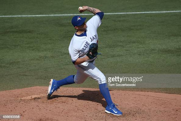 Brett Cecil of the Toronto Blue Jays delivers a pitch in the eighth inning during MLB game action against the Baltimore Orioles on September 28 2014...