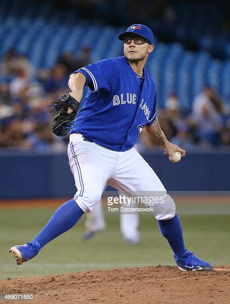 Brett Cecil of the Toronto Blue Jays delivers a pitch in the eighth inning during MLB game action against the Tampa Bay Rays on September 13 2014 at...