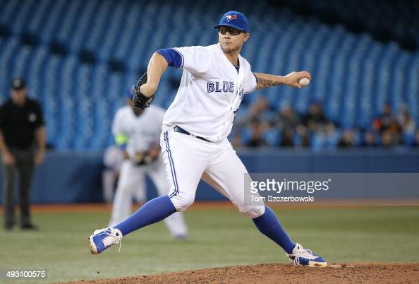 Brett Cecil of the Toronto Blue Jays delivers a pitch in the eighth inning during MLB game action against the Cleveland Indians on May 13 2014 at...