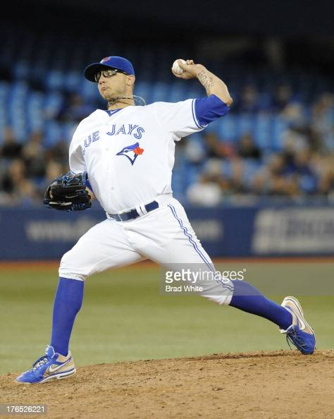 Brett Cecil of the Toronto Blue Jays delivers a pitch in the ninth inning during MLB game action against the Boston Red Sox August 14 2013 at Rogers...