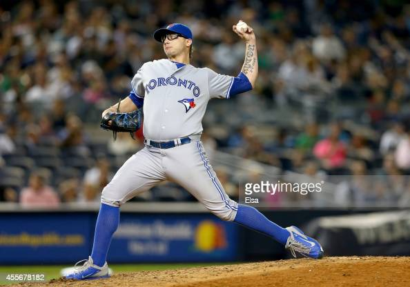 Brett Cecil of the Toronto Blue Jays delivers a pitch in the seventh inning against the New York Yankees on September 18 2014 at Yankee Stadium in...