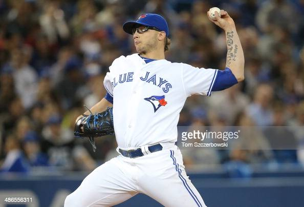 Brett Cecil of the Toronto Blue Jays delivers a pitch in the seventh inning during MLB game action against the Baltimore Orioles on April 24 2014 at...