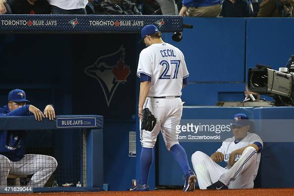 Brett Cecil of the Toronto Blue Jays exits the game after being relieved in the eighth inning during MLB game action against the Atlanta Braves on...