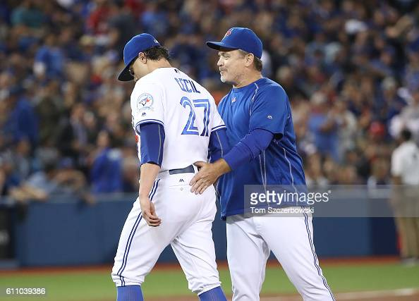 Brett Cecil of the Toronto Blue Jays exits the game as he is relieved by manager John Gibbons in the eighth inning during MLB game action against the...