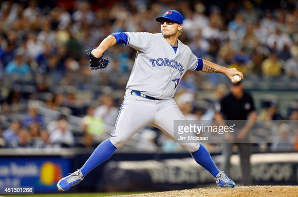 Brett Cecil of the Toronto Blue Jays in action against the New York Yankees at Yankee Stadium on June 18 2014 in the Bronx borough of New York City...