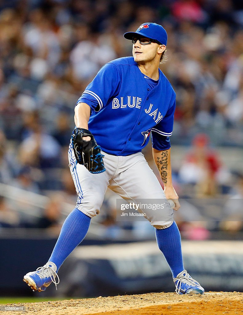 <a gi-track='captionPersonalityLinkClicked' href=/galleries/search?phrase=Brett+Cecil&family=editorial&specificpeople=4556338 ng-click='$event.stopPropagation()'>Brett Cecil</a> #27 of the Toronto Blue Jays in action against the New York Yankees at Yankee Stadium on September 20, 2014 in the Bronx borough of New York City. The Blue Jays defeated the Yankees 6-3.