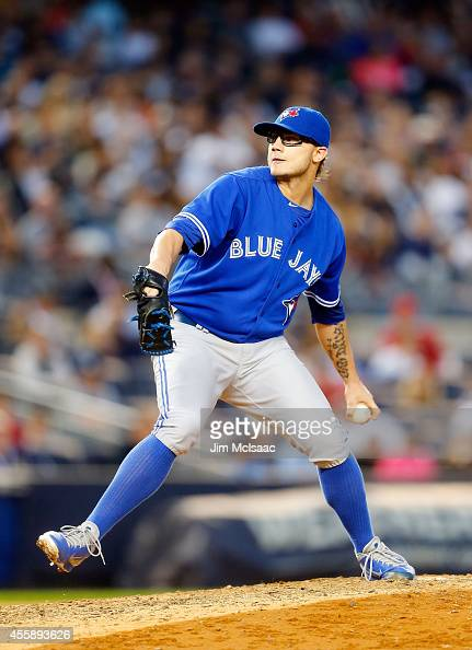 Brett Cecil of the Toronto Blue Jays in action against the New York Yankees at Yankee Stadium on September 20 2014 in the Bronx borough of New York...