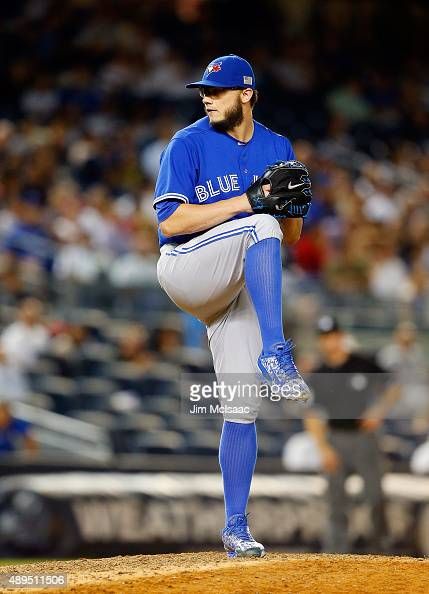 Brett Cecil of the Toronto Blue Jays in action against the New York Yankees at Yankee Stadium on September 11 2015 in the Bronx borough of New York...