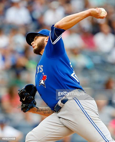 Brett Cecil of the Toronto Blue Jays in action against the New York Yankees at Yankee Stadium on September 12 2015 in the Bronx borough of New York...