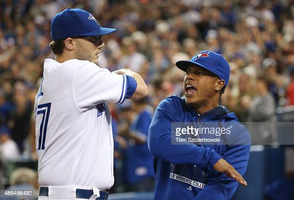 Brett Cecil of the Toronto Blue Jays is congratulated by Marcus Stroman after getting the last out of the eighth inning during MLB game action...