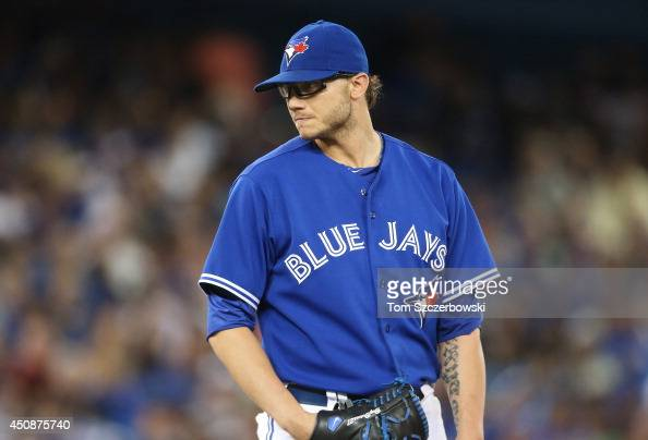Brett Cecil of the Toronto Blue Jays looks in before delivering a pitch in the ninth inning during MLB game action against the St Louis Cardinals on...