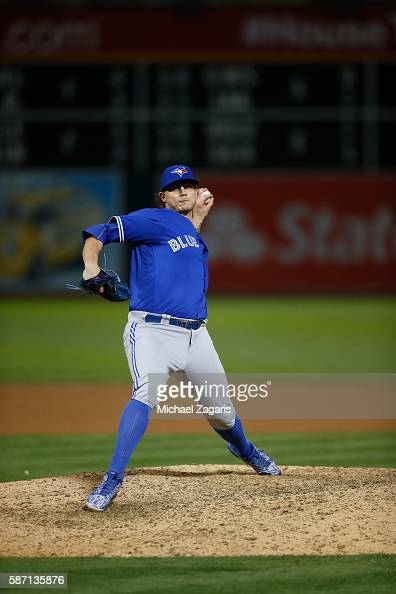Brett Cecil of the Toronto Blue Jays pitches during the game against the Oakland Athletics at the Oakland Coliseum on July 15 2016 in Oakland...