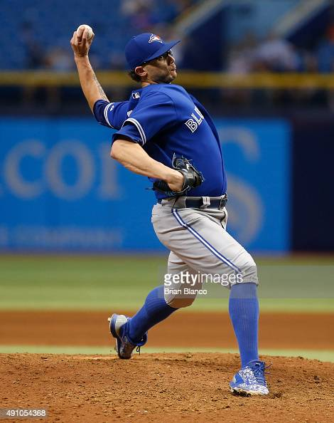 Brett Cecil of the Toronto Blue Jays pitches during the ninth inning of a game against the Tampa Bay Rays on October 2 2015 at Tropicana Field in St...